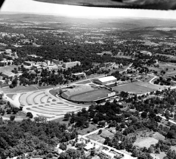 An aerial view of Razorback Stadium, circa 1955. At the south end of the stadium is Barnhill Field House (later Barnhill Arena), which opened a year earlier.