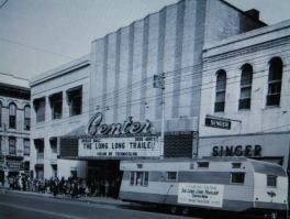 "The Center Theater, 407 Main St. in Little Rock, as it looked in 1954. Moviegoers formed a line around the block to see the new Lucille Ball movie, ""The Long, Long Trailer."""