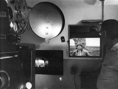 """A view from the projection booth at Cinema 150 in 1970. """"Patton"""" is playing in the background."""