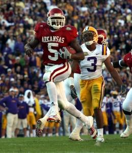 Arkansas Democrat-Gazette/RICK MCFARLAND--1123//07-- Arkansas Darren McFadden runs from LSU defenders at Tiger Stadium in Baton Rouge Friday, Nov. 23, 2007.
