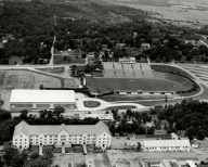 "This 1955 photo shows a recently completed Barnhill Fieldhouse adjacent to the south endzone of Razorback Stadium. Funding for the new facility came primarily at the behest of Gov. Francis Cherry, who was described in the 1954 Razorback as a ""frequent visitor"" to the Hill who ""rarely misses a Razorback football game which is in or near Arkansas."""