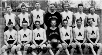 In the decade following the foundation of the Southwest Conference in 1915, Texas and Texas A&M combined to win nine league titles in basketball. But in only their third season of competition, the Razorbacks captured the 1926 SWC championship in dominating fashion. Guided by Schmidt, standing in the middle of the back row, Arkansas posted a 23-2 record -- going 11-1 in the SWC -- and went 4-0 against Texas and Texas A&M. Schmidt was also grooming his protege: standing to his right is Glen Rose, who would return in 1934 lift his alma mater to even greater heights.