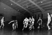 Lambert coached Arkansas from 1943 to 1949. Never winning more than 19 games in a season, Lambert's Hogs managed to capture to SWC titles (1944, 1949), qualified for two NCAA Tournaments, and reached the Final Four in 1945. Arkansas was invited to the 1944 tournament but had to withdraw after a car accident killed an assistant coach and severely injured two players. Eventual champion Utah replaced Arkansas in the tournament.