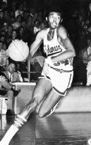 Dean Tolson left Arkansas with career scoring and rebounding averages of 18.3 and 11.7 -- the latter of which remains the school record. After a brief professional career, Tolson returned to Arkansas in 1987 to complete his degree. Graduating from college was especially noteworthy for Tolson, because he was illiterate while attending UA.