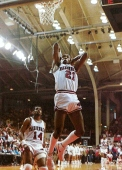 During a trip to rival Texas. Alvin Robertson, pictured above, recorded the school's first triple-double in a four-point win over the Longhorns. Robertson tallied 23 points, 10 assists and 11 rebounds. Later, in the NBA, Robertson became one of only four players -- and the only non-center -- to record a quadruple-double.