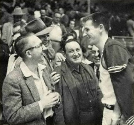 Arkansas guard Fred Grim chats with fans after a game in Barnhill Fieldhouse during the 1956 season. Grim, who played for the Hogs from 1956-1958, was named first team All-SWC and honorable mention All-American in 1958.