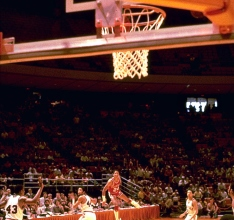 Arkansas' last-second win over Louisville in the 1981 tournament endures more than three decades later. Often listed among top 10 lists of classic NCAA Tournament endings, U.S. Reed's half-court buzzer-beater sent the Hogs to their third Sweet 16 and knocked out the defending champions. Arkansas inbounded the ball under its own goal and Reed dribbled frantically to mid-court, hounded by two Cardinals defenders. Reed launched a 49-foot bomb with one tick left on the clock and the buzzer sounded while the ball sailed toward the rafters. After emphatically splashing through the hoop, a contingent of Razorbacks fans, players, coaches and cheerleaders swarmed the court.
