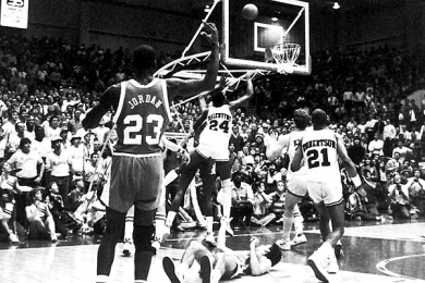 Playing without a shot clock in those days, Arkansas forced North Carolina to play at a slower place. But the Tar Heels overcame a 10-point deficit in the second half and took a 64-63 lead after two consecutive baskets from Jordan. With nine seconds left, Alvin Robertson tried a jump shot but passed at the last second to Charles Balentine, who snagged the ball before it went out of bounds and flipped it into the hoop. North Carolina called a timeout but its last-second heave rimmed out and fans stormed the court.