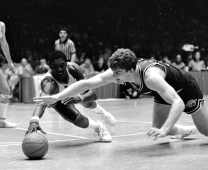 The Hogs struggled for most of the 1984-85 season, reaching their nadir in a 17-point loss to defending national champion Georgetown in which they scored just 39 points. After limping to a 10-6 conference record — Arkansas' fewest victories since 1976 — a late season surge earned the Hogs an at-large berth in the NCAA Tournament. Arkansas beat Iowa in the first round before falling to Chris Mullin and No. 3 St. John's.