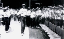 "Jim Robken was the seminal off-court contribution to Arkansas basketball. Installed as band director in 1978, Robken, pictured above, turned Barnhill into his musical playground. As ""The University of Arkansas Razorback Band: A History, 1874-2004"" noted, ""he renamed the (Pep Band) the 'Hogwild Band' and became a legend stirring up the fans in the fieldhouse to the strains of 'The William Tell Overture' and galloping around the building wearing a Lone Ranger mask."""