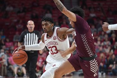 The Hogs marked another milestone on the same night they honored Coach Richardson: hosting UALR for an exhibition game. It was the first meeting between the two in-state schools.
